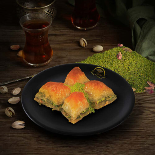 turkish pakhlava with honey on the table